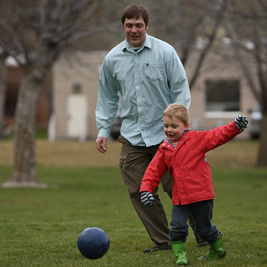 Daniel Parker and son playing soccer.